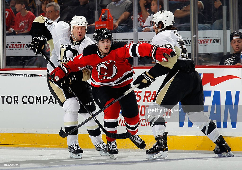 <a gi-track='captionPersonalityLinkClicked' href=/galleries/search?phrase=Adam+Henrique&family=editorial&specificpeople=4043225 ng-click='$event.stopPropagation()'>Adam Henrique</a> #14 of the New Jersey Devils skates against the Pittsburgh Penguins at the Prudential Center on April 25, 2013 in Newark, New Jersey. The Devils defeated the Penguins 3-2.