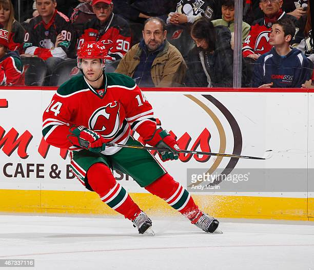 Adam Henrique of the New Jersey Devils skates against the Pittsburgh Penguins during the game at the Prudential Center on March 17 2015 in Newark New...
