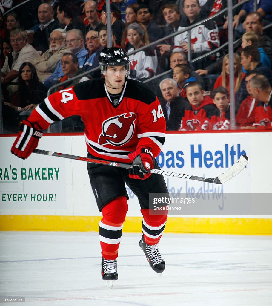 <a gi-track='captionPersonalityLinkClicked' href=/galleries/search?phrase=Adam+Henrique&family=editorial&specificpeople=4043225 ng-click='$event.stopPropagation()'>Adam Henrique</a> #14 of the New Jersey Devils skates against the Vancouver Canucks at the Prudential Center on October 24, 2013 in Newark, New Jersey. The Canucks defeated the Devils 3-2 in the shootout.