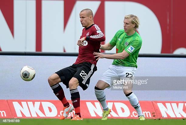 Adam Hlousek of Nuernberg and Frantisek Rajtoral of Hannover compete for the ball during the Bundesliga match between 1 FC Nuernberg and Hannover 96...