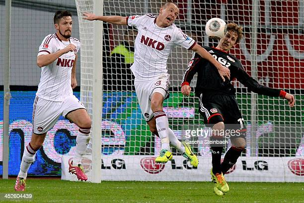 Adam Hlousek of Nuernberg and Stefan Kiessling of Leverkusen battle for the ball during the Bundesliga match between Bayer Leverkusen and 1 FC...