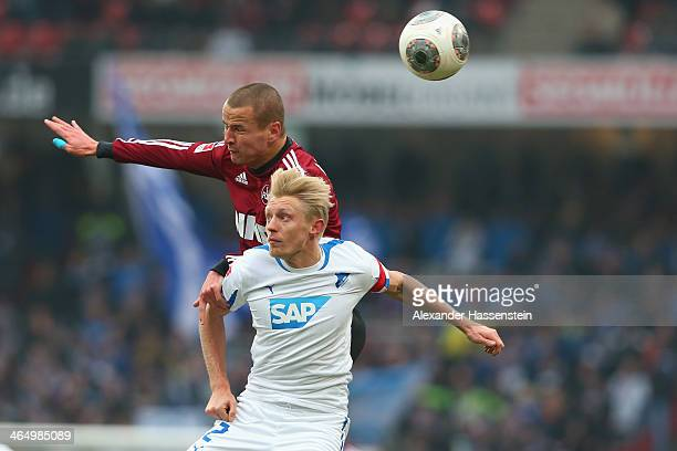 Adam Hlousek of Nuernberg battles for the ball with Andreas Beck of Hoffenheim during the Bundesliga match between 1 FC Nuernberg and TSG 1899...