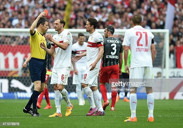 Adam Hlousek of Stuttgart is shown a yellow red card by referee Wolfgang Stark during the Bundesliga match between VfB Stuttgart and SC Freiburg at...
