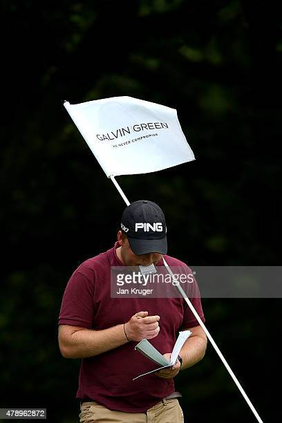 Adam Hodkinson of ChorltonCumHardy GC marks his card during the Galvin Green PGA Assistants' Championship North Qualifier at Penwortham Golf Club on...