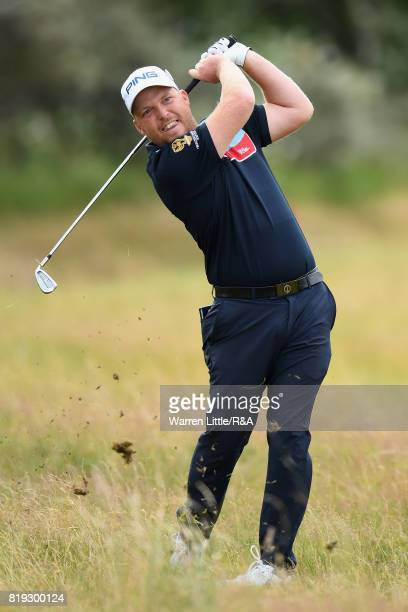 Adam Hodkinson of England hits his second shot on the 1st hole during the first round of the 146th Open Championship at Royal Birkdale on July 20...