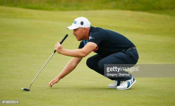 Adam Hodkinson of England lines up a putt on the 4th green during the first round of the 146th Open Championship at Royal Birkdale on July 20 2017 in...