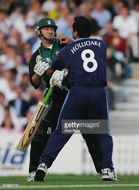 Adam Hollioake of Surrey has a pretend punchup with Andy Bichel of Worcestershire during the Twenty20 QuarterFinal match between Surrey Lions and...