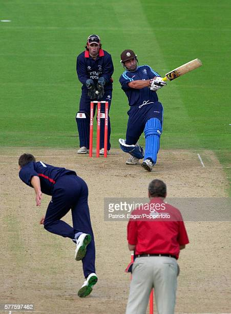 Adam Hollioake of Surrey hits a delivery from Simon Cook of Middlesex during his 65 not out in the Twenty20 Cup match between Middlesex Crusaders and...