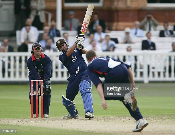Adam Hollioake of Surrey hits out during the Middlesex v Surrey Twenty20 Cup match at Lords on July 15 2004 in London England