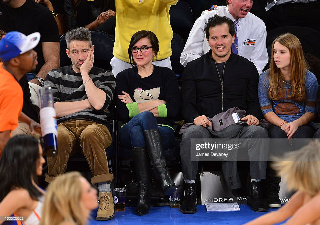 Adam Horovitz and John Leguizamo attend the Milwaukee Bucks vs New York Knicks game at Madison Square Garden on February 1, 2013 in New York City.