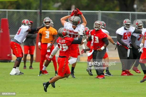 Adam Humphries goes up high to make the catch above Javien Elliott during the Tampa Bay Buccaneers OTA on May 25 2017 at One Buccaneer Place in Tampa...