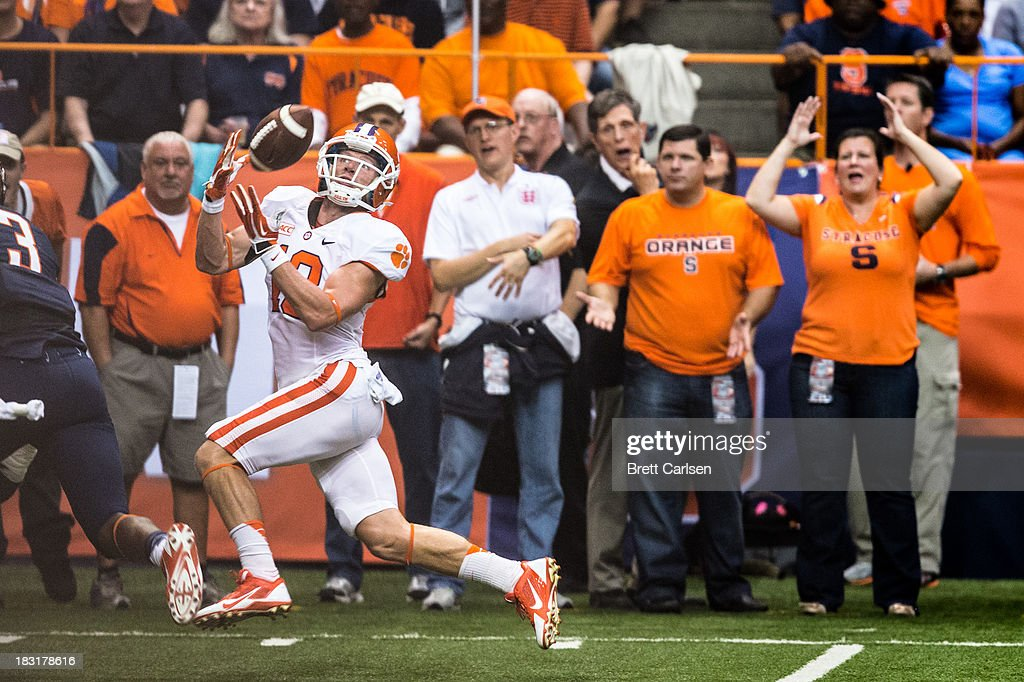 Adam Humphries #13 of Clemson Orange catches Clemson's third touchdown to raise their lead to 21-0 over Syracuse Orange in first quarter on October 5, 2013 at the Carrier Dome in Syracuse, New York.