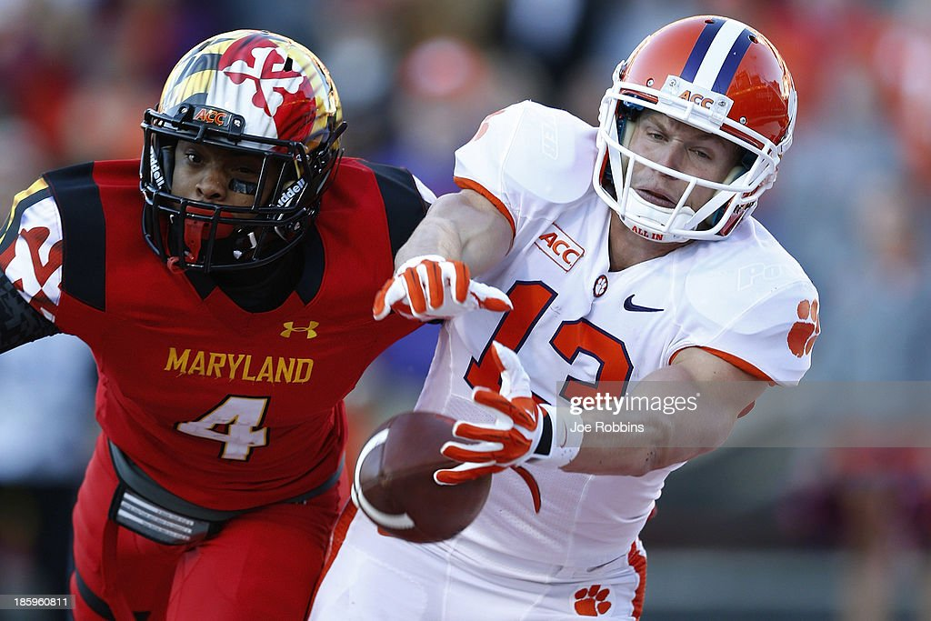 Adam Humphries #13 of the Clemson Tigers tries to make a reception against William Likely #4 of the Maryland Terrapins during the first half of the game at Byrd Stadium on October 26, 2013 in College Park, Maryland.
