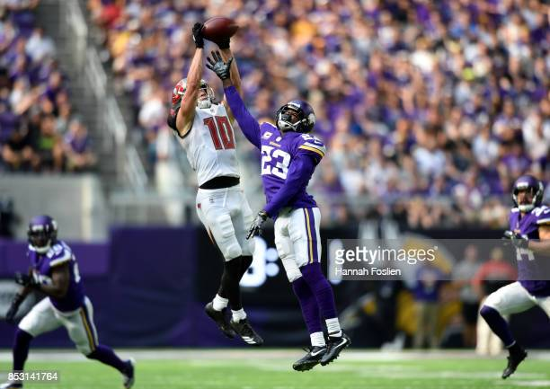 Adam Humphries of the Tampa Bay Buccaneers catches the ball over defender Terence Newman of the Minnesota Vikings in the second half of the game on...