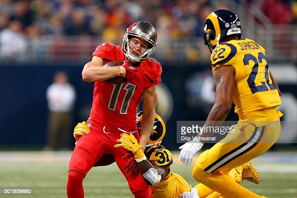 Adam Humphries of the Tampa Bay Buccaneers is tackled by Maurice Alexander of the St Louis Rams in the first quarter at the Edward Jones Dome on...