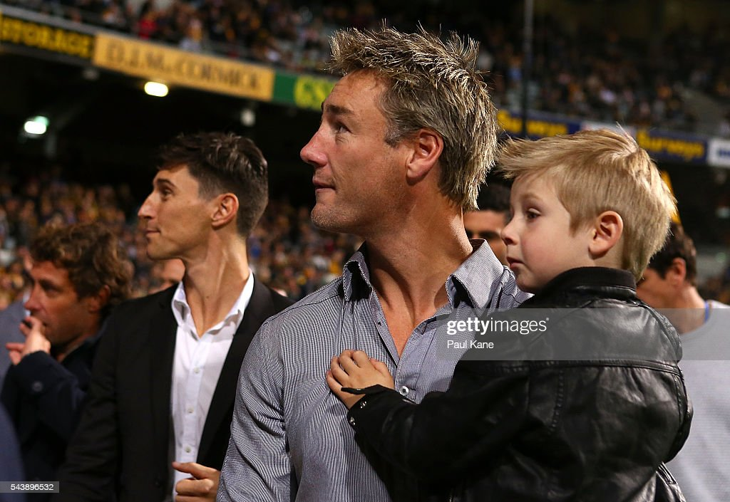 <a gi-track='captionPersonalityLinkClicked' href=/galleries/search?phrase=Adam+Hunter+-+Australian+Rules+Football+Player&family=editorial&specificpeople=11365041 ng-click='$event.stopPropagation()'>Adam Hunter</a> walks a lap of honour with team mates celebrating the West Coast Eagles 2006 Premiership anniversary during the round 15 AFL match between the West Coast Eagles and the Essendon Bombers at Domain Stadium on June 30, 2016 in Perth, Australia.