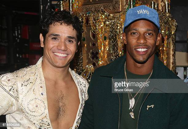 Adam Jacobs as 'Aladdin' and NY Giants Victor Cruz pose backstage at 'Disney's Aladdin' on Broadway at The New Amsterdam Theatre on October 15 2016...