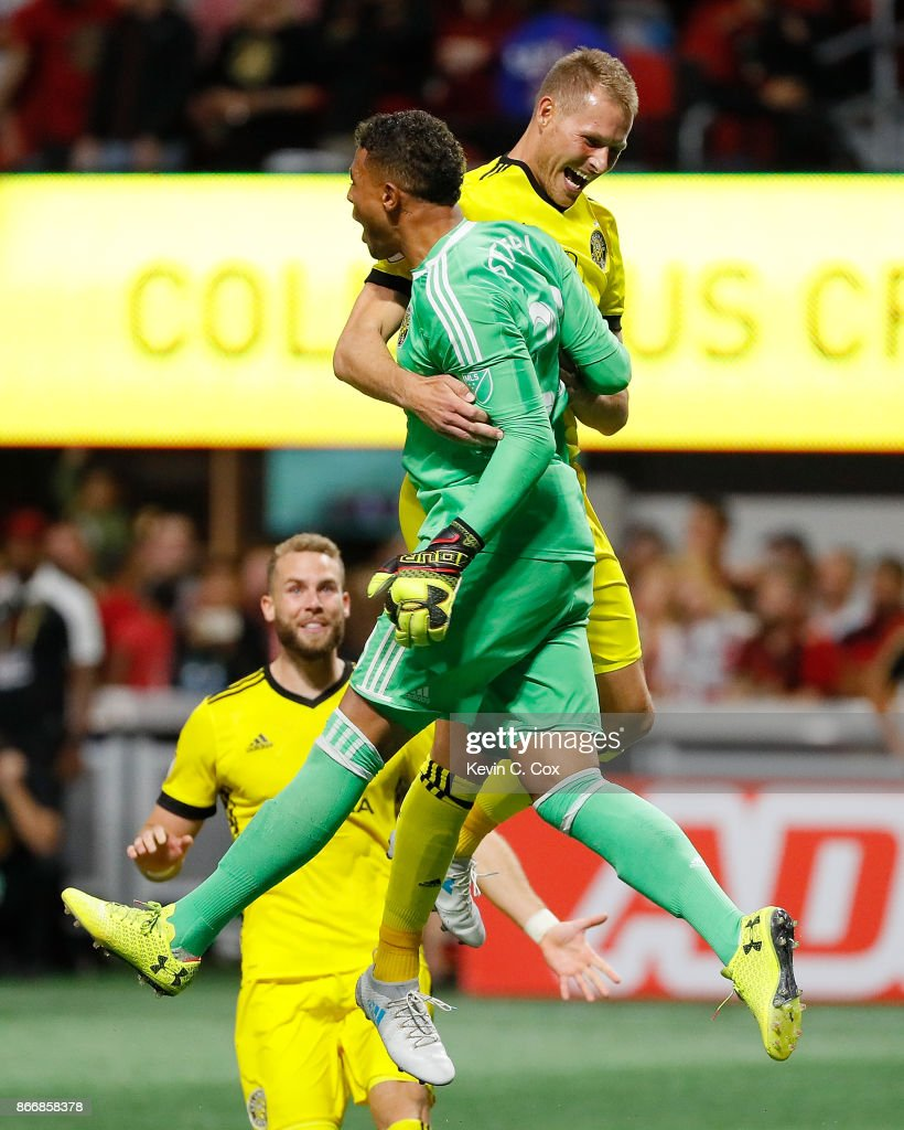 Adam Jahn #12 of Columbus Crew reacts with goalkeeper Zack Steffen #23 after converting a penalty kick to give the Crew a win over the Atlanta United 3-1 on penalties during the Eastern Conference knockout round at Mercedes-Benz Stadium on October 26, 2017 in Atlanta, Georgia.