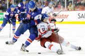 Adam Janosik of Team Slovakia and Tomas Hyka of Team Czech Republic battle for the puck during the 2012 World Junior Hockey Championship Fifth Place...