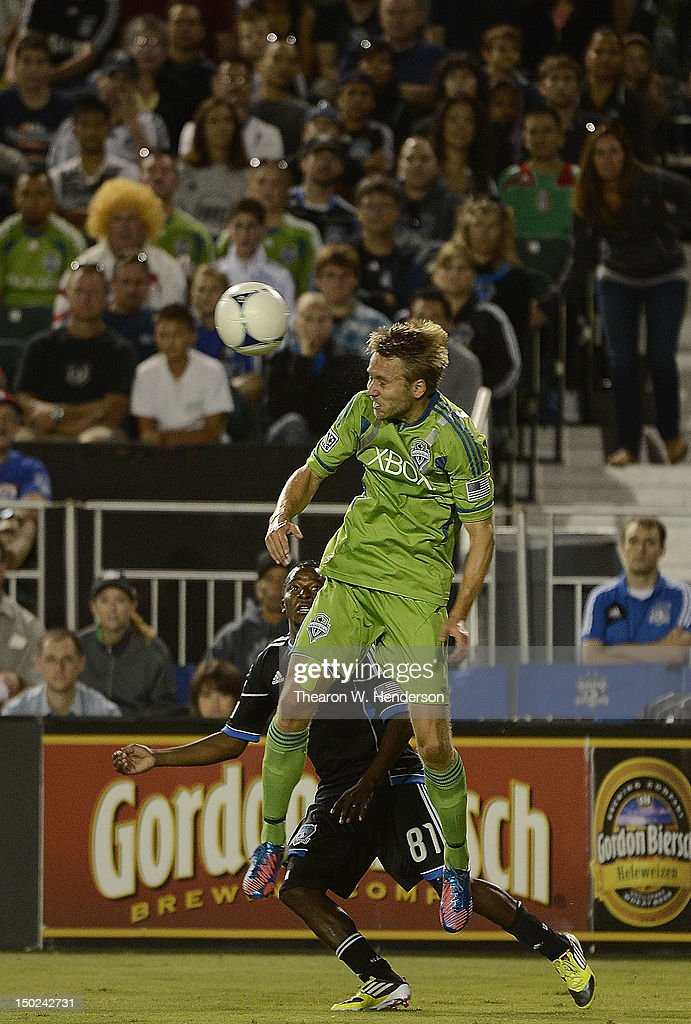 Adam Johansson #5 of the Seattle Sounders hits a header in front of Marvin Chavez #81 of the San Jose Earthquakes during an MLS Soccer game at Buck Shaw Stadium on August 11, 2012 in Santa Clara, California. The Earthquakes won the game 2-1.