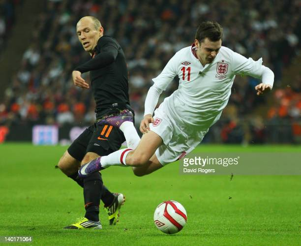 Adam Johnson of England battles for the ball with Arjen Robben of Netherlands during the international friendly match between England and Netherlands...