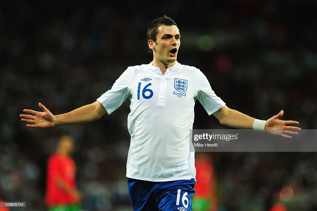 <a gi-track='captionPersonalityLinkClicked' href=/galleries/search?phrase=Adam+Johnson+-+Soccer+Player&family=editorial&specificpeople=6720094 ng-click='$event.stopPropagation()'>Adam Johnson</a> of England celebrates scoring the third goal of the game during the UEFA EURO 2012 Group G Qualifying match between England and Bulgaria at Wembley Stadium on September 3, 2010 in London, England.