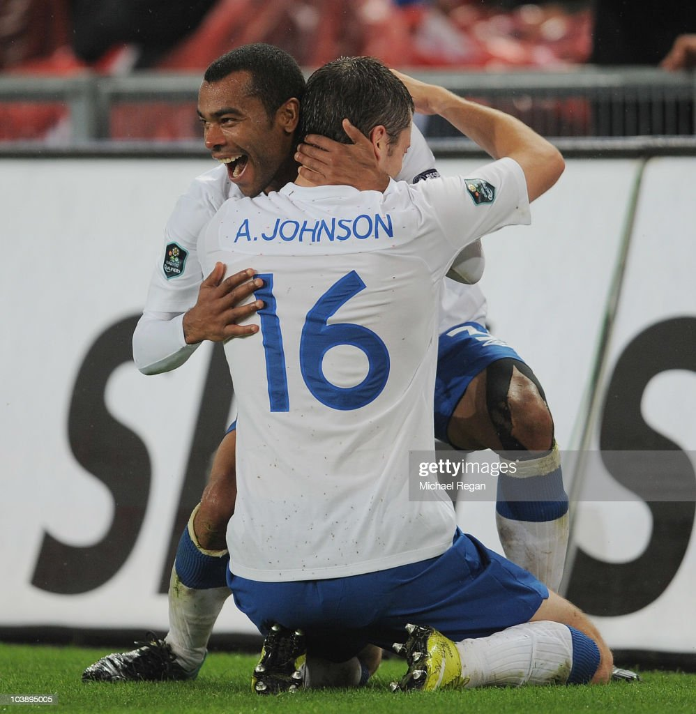 <a gi-track='captionPersonalityLinkClicked' href=/galleries/search?phrase=Adam+Johnson+-+Soccer+Player&family=editorial&specificpeople=6720094 ng-click='$event.stopPropagation()'>Adam Johnson</a> of England celebrates scoring with <a gi-track='captionPersonalityLinkClicked' href=/galleries/search?phrase=Ashley+Cole&family=editorial&specificpeople=201831 ng-click='$event.stopPropagation()'>Ashley Cole</a> during the UEFA EURO 2012 Group G Qualifier between Switzerland and England at St Jakob Park on September 7, 2010 in Basel, Switzerland.