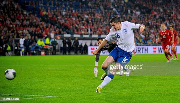 Adam Johnson of England scores his team's second goal during the EURO 2012 Group G Qualifier between Switzerland and England at St Jakob Park on...