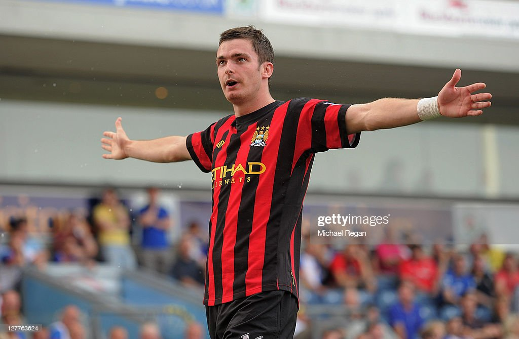 <a gi-track='captionPersonalityLinkClicked' href=/galleries/search?phrase=Adam+Johnson+-+Soccer+Player&family=editorial&specificpeople=6720094 ng-click='$event.stopPropagation()'>Adam Johnson</a> of Manchester City celebrates after scoring the opening goal of the Barclays Premier League match between Blackburn Rovers and Manchester City at Ewood Park on October 1, 2011 in Blackburn, England.