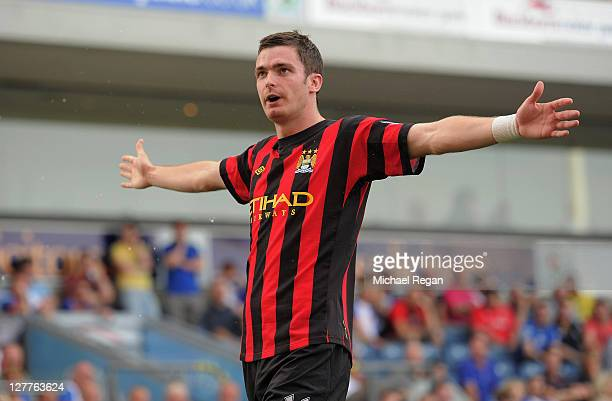 Adam Johnson of Manchester City celebrates after scoring the opening goal of the Barclays Premier League match between Blackburn Rovers and...