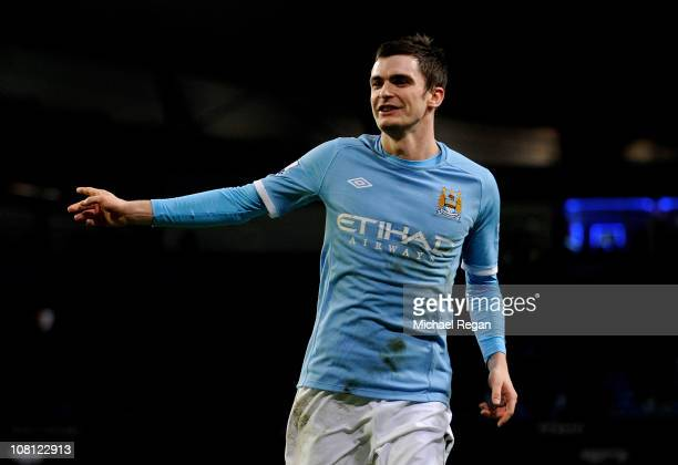 Adam Johnson of Manchester City celebrates scoring his team's third goal during the FA Cup sponsored by EOn Third Round Replay match between...