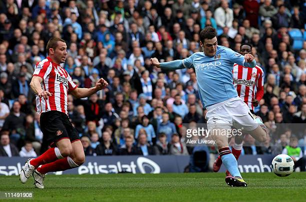 Adam Johnson of Manchester City scores the opening goal during the Barclays Premier League match between Manchester City and Sunderland at the City...