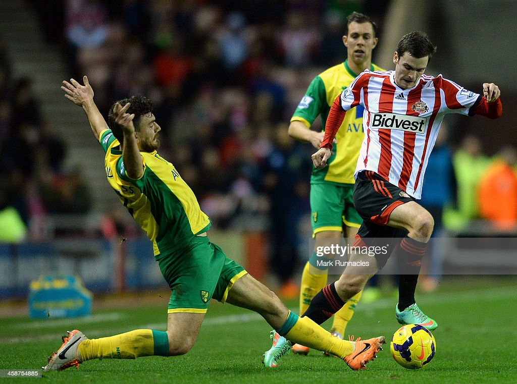 <a gi-track='captionPersonalityLinkClicked' href=/galleries/search?phrase=Adam+Johnson+-+Soccer+Player&family=editorial&specificpeople=6720094 ng-click='$event.stopPropagation()'>Adam Johnson</a> of Sunderland and <a gi-track='captionPersonalityLinkClicked' href=/galleries/search?phrase=Robert+Snodgrass&family=editorial&specificpeople=5488953 ng-click='$event.stopPropagation()'>Robert Snodgrass</a> of Norwich City in action during the Barclays Premier League match between Sunderland and Norwich City at the Stadium of Light on December 21, 2013 in Sunderland, England.