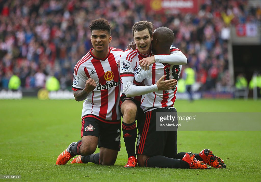 Adam Johnson (C) of Sunderland celebrates scoring his team's first goal with his team mates DeAndre Yedlin (L) and Jermain Defoe (R) during the Barclays Premier League match between Sunderland and Newcastle United at Stadium of Light on October 25, 2015 in Sunderland, England.