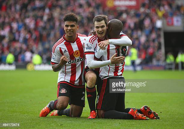 Adam Johnson of Sunderland celebrates scoring his team's first goal with his team mates DeAndre Yedlin and Jermain Defoe during the Barclays Premier...