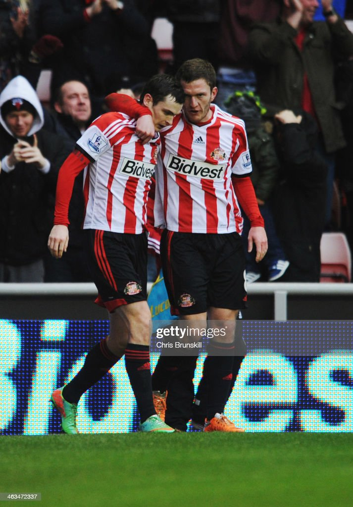 <a gi-track='captionPersonalityLinkClicked' href=/galleries/search?phrase=Adam+Johnson+-+Soccer+Player&family=editorial&specificpeople=6720094 ng-click='$event.stopPropagation()'>Adam Johnson</a> of Sunderland celebrates with <a gi-track='captionPersonalityLinkClicked' href=/galleries/search?phrase=Craig+Gardner&family=editorial&specificpeople=685283 ng-click='$event.stopPropagation()'>Craig Gardner</a> (R) as he scores their second goal during the Barclays Premier League match between Sunderland and Southampton at Stadium of Light on January 18, 2014 in Sunderland, England.