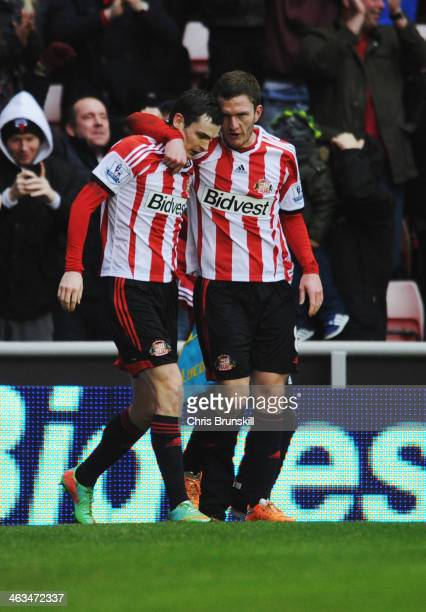 Adam Johnson of Sunderland celebrates with Craig Gardner as he scores their second goal during the Barclays Premier League match between Sunderland...