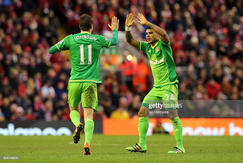 Adam Johnson (L) of Sunderland celebrates with DeAndre Yedlin after he scored the first Sunderland goal with a free kick during the Barclays Premier match between Liverpool and Sunderland at Anfield on February 06, 2016 in Liverpool, England.