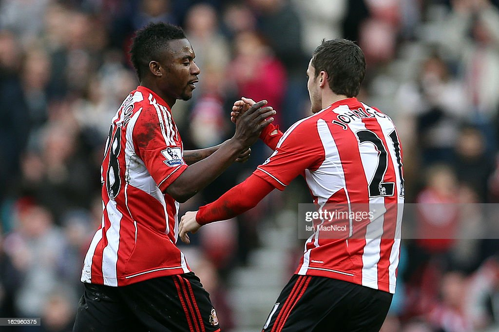 <a gi-track='captionPersonalityLinkClicked' href=/galleries/search?phrase=Adam+Johnson+-+Soccer+Player&family=editorial&specificpeople=6720094 ng-click='$event.stopPropagation()'>Adam Johnson</a> of Sunderland congratulates Stephane Sessegnon on his goal during the Barclays Premier League match between Sunderland and Fulham at the Stadium of Light on March 02, 2013 in Sunderland, England.