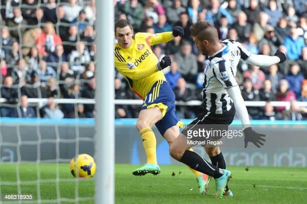 Adam Johnson of Sunderland scores his team's second goal past Davide Santon of Newcastle during the Barclays Premier League match between Newcastle...