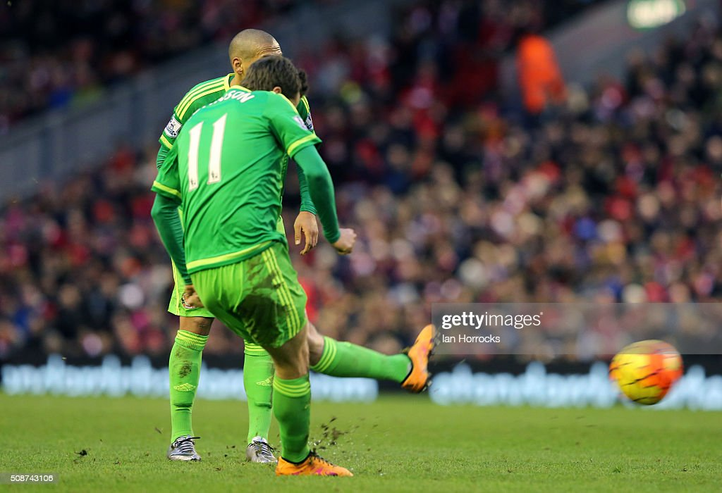 Adam Johnson of Sunderland scores the first Sunderland goal with a free kick during the Barclays Premier match between Liverpool and Sunderland at Anfield on February 06, 2016 in Liverpool, England.