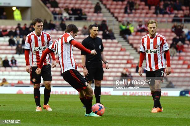 Adam Johnson of Sunderland scores the opening goal from a free kick during the Budweiser FA Cup third round match between Sunderland and Carlisle...