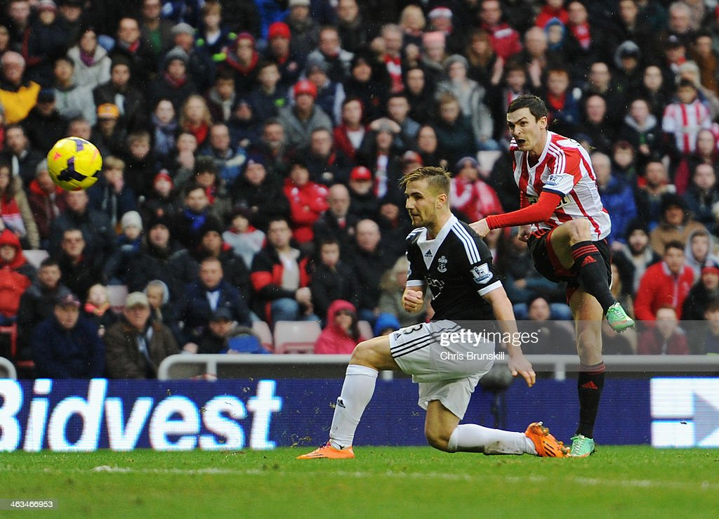 Adam Johnson of Sunderland shoots past Luke Shaw of Southampton to score their second goal during the Barclays Premier League match between Sunderland and Southampton at Stadium of Light on January 18, 2014 in Sunderland, England.