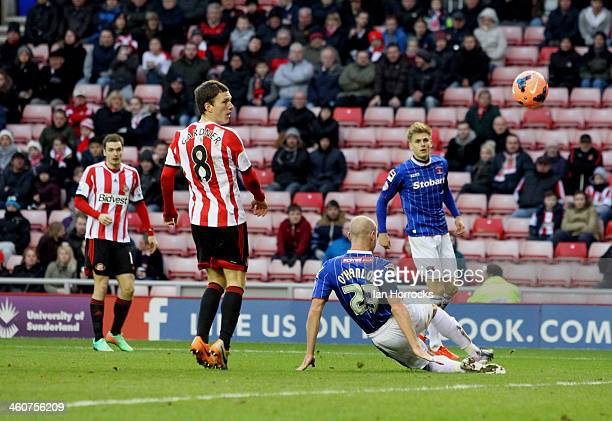 Adam Johson of Sunderland watches as his shot into the penalty area deflects off Sean O'Hanlon of Carlisle for Sunderland's second goal during the...