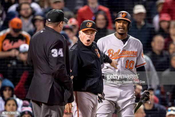 Adam Jones and manager Buck Showalter of the Baltimore Orioles argue with home plate umpire Sam Holbrook after being ejected from the game after...