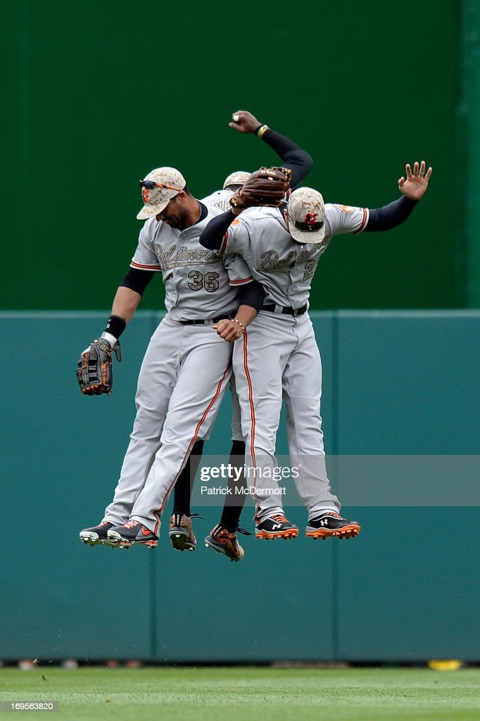Adam Jones Chris Dickerson and Nick Markakis of the Baltimore Orioles celebrate after the Orioles defeated the Washington Nationals 62 during an...