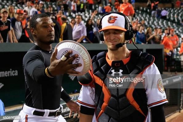 Adam Jones hits catcher Caleb Joseph of the Baltimore Orioles with a pie to the face following the Orioles 42 win over the Toronto Blue Jays at...