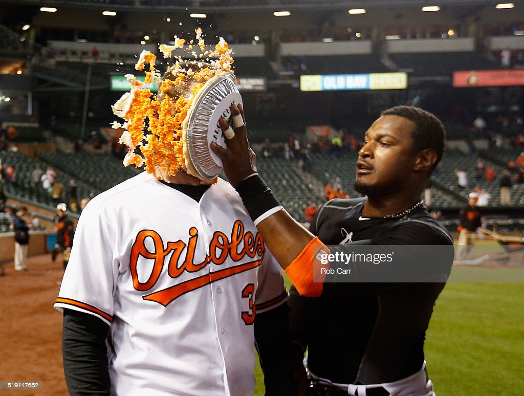 <a gi-track='captionPersonalityLinkClicked' href=/galleries/search?phrase=Adam+Jones+-+Baseball&family=editorial&specificpeople=5460465 ng-click='$event.stopPropagation()'>Adam Jones</a> #10 (R) hits <a gi-track='captionPersonalityLinkClicked' href=/galleries/search?phrase=Matt+Wieters&family=editorial&specificpeople=4498276 ng-click='$event.stopPropagation()'>Matt Wieters</a> #32 of the Baltimore Orioles in the face with pie after the Orioles defeated the Minnesota Twins 3-2 during their Opening Day game Oriole Park at Camden Yards on April 4, 2016 in Baltimore, Maryland.