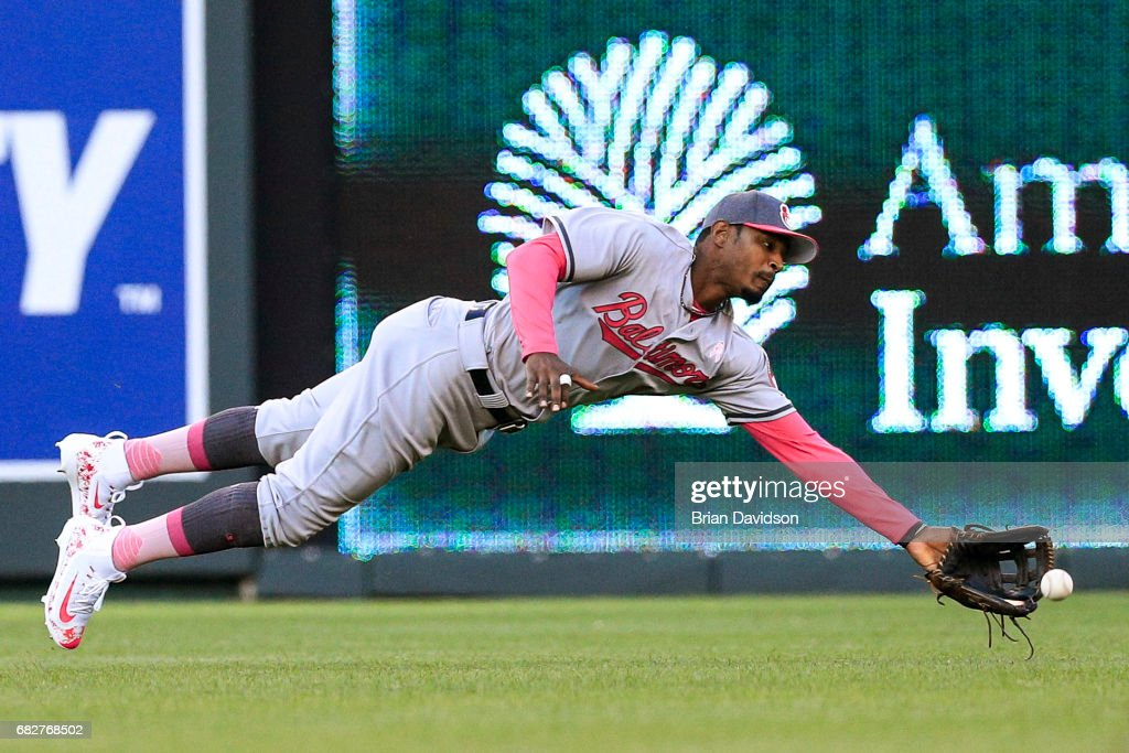 Adam Jones #10 of the Baltimore Orioles attempts to catch the ball but misses during the game against the Kansas City Royals at Kauffman Stadium on May 13, 2017 in Kansas City, Missouri. Players are wearing pink to celebrate Mother's Day weekend and support breast cancer awareness.