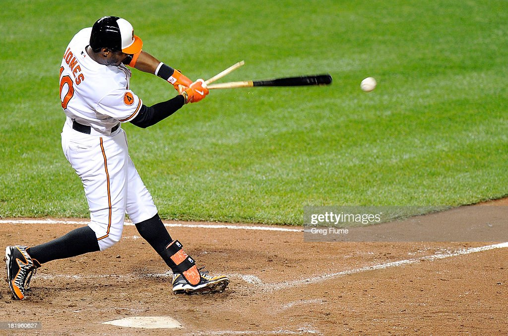 Adam Jones #10 of the Baltimore Orioles breaks his bat on a groundout in the sixth inning against the Toronto Blue Jays at Oriole Park at Camden Yards on September 26, 2013 in Baltimore, Maryland.